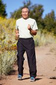 stock photo of hairline  - Senior man jogging - JPG