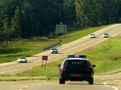 foto of lightbar  - an officer and vehicle on patrol along an interstate highway in the u - JPG