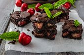 stock photo of cherry  - Chocolate brownies with cherries homemade with just picked cherries and mint - JPG