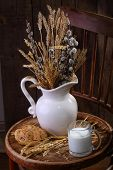 pic of willow  - Light morning meal with milk and fresh bread and a bouquet from cones and a willow - JPG