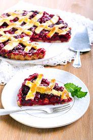 stock photo of crust  - Classic Sour Cherry Pie with Lattice Crust - JPG