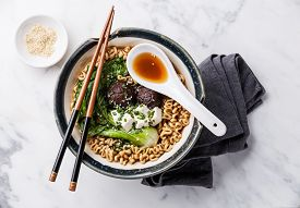 foto of noodles  - Miso Ramen Asian noodles with shiitake tofu and cabbage pak choi in bowl on white marble background - JPG
