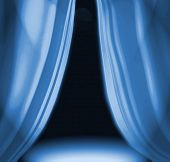 Blue Drapes On Empty Theatre Stage