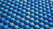Countless rows of blue empty stadium seats