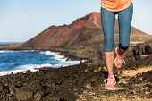 Trail running athlete woman runner legs and shoes lower body. Fitness woman jogging living active li poster
