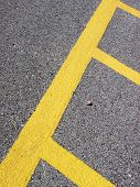 Background Texture Asphalt With Yellow Stripes