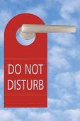 Do Not Disturb Tag On Handle Over Sky