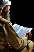 Muslim reading Koran