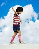 Kid - balance walking on wall