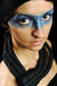 Very pretty woman with dark  scarf and colorful mask eyes, fashion stylish model