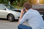 Man Calling Car Mechanic Insurance Assistance After Car Accident poster