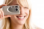 woman taking photo with small digital camera