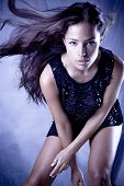 young beautiful female model with long flyin hair, studio shot
