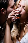 young couple in love celebrate with wine