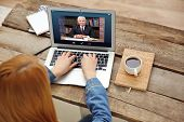 Woman video conferencing with lawyer on laptop. Video call and online service concept. poster