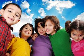 stock photo of school child  - Happy group of children outdoor - JPG