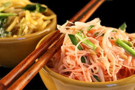 foto of thai food  - Thai style fried noodles in a bowl on a black background  - JPG