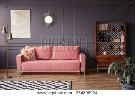 poster of A Marble Beige Painting And A Sunburst Golden Mirror On A Gray Wall With Molding In A Stylish Living