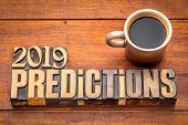 2019 prediction concept - text in vintage letterpress wood type printing blocks with a cup of coffee poster