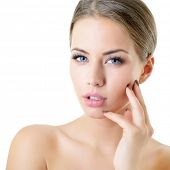 Young woman touching her face and neck. Beauty treatment for young beautiful female face. Skin care, poster