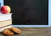 Back To School, Education Concept. Book, Useful  Whole-grain Cookies And Apple On Classroom Table In poster