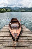 Bled, Slovenia - May 20, 2018: Beautiful Lake Bled In The Julian Alps And Old Wooden Boat. Mountains poster