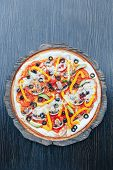Vegetarian Pizza On A Wooden Board. Italian Vegetarian Pizza. poster
