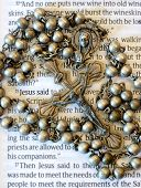 Antique rosary beads on bible script