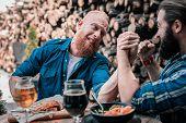 Bearded Red-haired Man Having No Strength For Battling In Arm Wrestling poster
