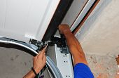 Repairman Repair Garage Door Opener. Garage Door Replacement, Garage Door Repair. poster