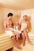 Happy family with a child in a sauna