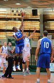 KAPOSVAR, HUNGARY - OCTOBER 15: Jozsef Lekli (white 14) in action at a Hugarian National Championship basketball game Kaposvar (white) vs. Jaszbereny (blue) on October 15, 2011 in Kaposvar, Hungary.