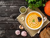 Funny Food For Halloween. Pumpkin Puree Soup, Spider Web, Dark Old Wooden Table, Top View, Copy Spac poster