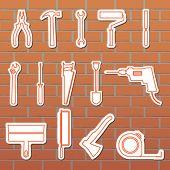 Vector illustration mkonok tools on the wall fonekirpichnoy