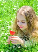 Tenderness Concept. Girl On Calm Face Holds Red Tulip Flower On Sunny Spring Day. Girl With Long Hai poster