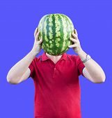 A Man Holds At The Level Of The Head Of A Ripe Tasty Watermelon. Watermelon Instead Of The Head. Adv poster