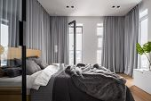 Luxury Bedroom Interior With Double Bed And Gray Window Curtains poster