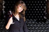 Beautiful Young Woman Tasting Wine.