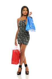 stock photo of african american woman  - Young African American Woman with shopping bags isolated on a white background - JPG