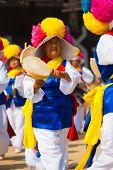 Mature Korean Woman Traditional Handheld Drum