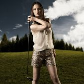 Beautiful Woman With Golfclub In The Right Hand