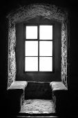 Interior of ancient prison. Black and white photography.