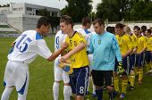 KAPOSVAR, HUNGARY - JULY 21: Competitors shake hands before the VIII. Youth Football Festival U17 Fi