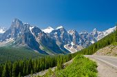 stock photo of bend over  - Nice mountain road over fantastic rocky mountains - JPG