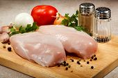 image of turkey-hen  - Raw chicken breasts on cutting board - JPG
