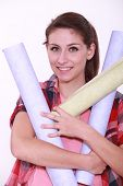 Woman charged with rolls of wallpaper