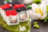 Chess Maki Sushi - Roll with Prawn and Feta Cheese inside. Topped with Black and Red Tobiko (flying
