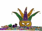 picture of mardi gras mask  - A group of mardi gras beads an mask with copy space - JPG