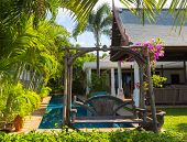 Swimming pool and wooden Swing of the luxury villa, Samui, Thailand