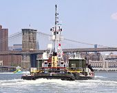 Tug And Brooklyn Bridge